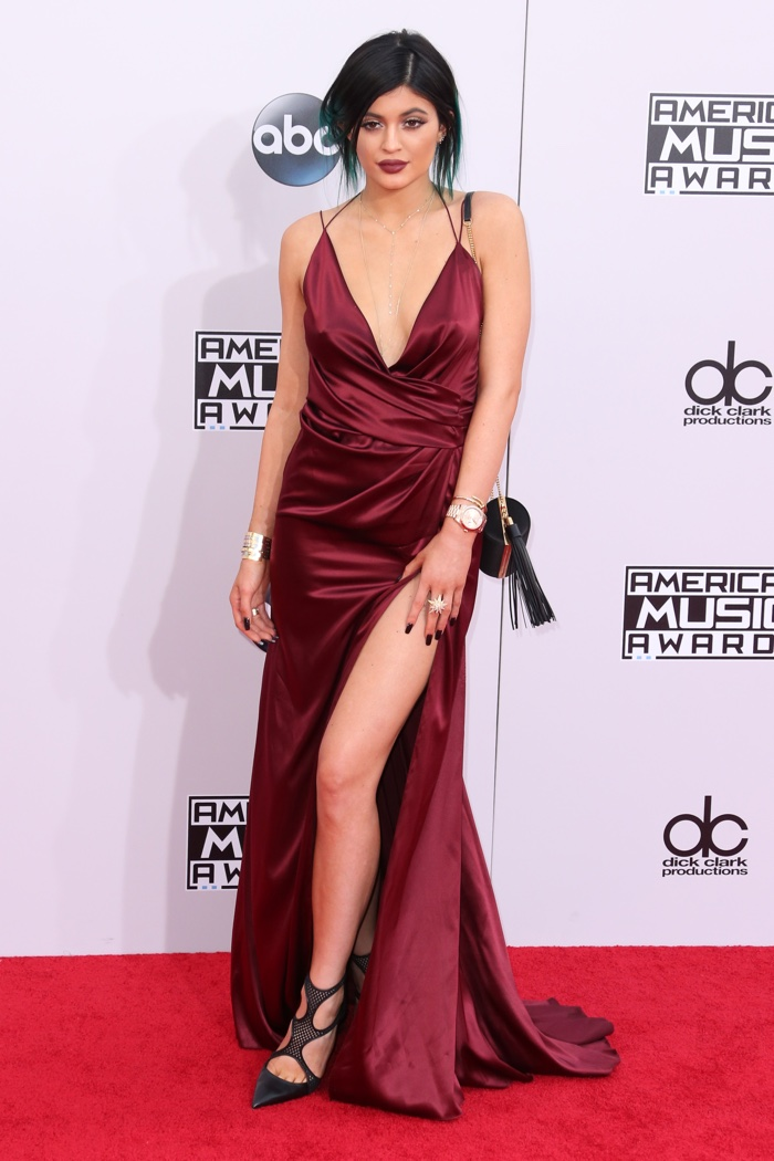 Later in 2014, Kylie Jenner would wear Alexandre Vauthier Couture again at the American Music Awards with a oxblood slip dress. Photo: DFree / Shutterstock.com