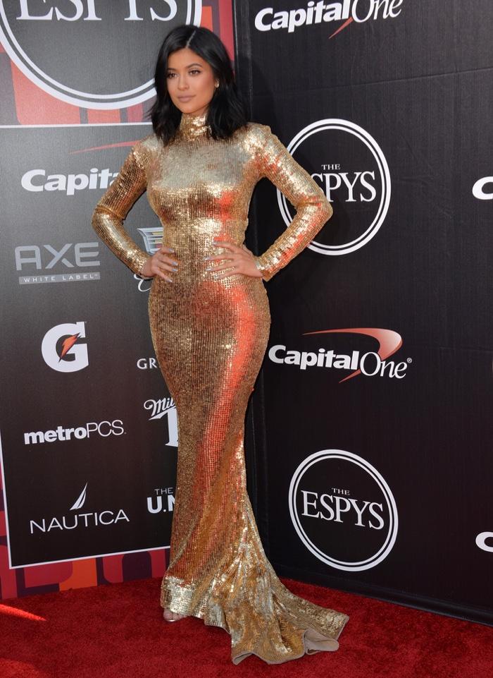 Kylie Jenner glittered at the 2015 ESPY Awards wearing a gold Shady Zeineldine dress. Photo: Jaguar PS / Shutterstock.com