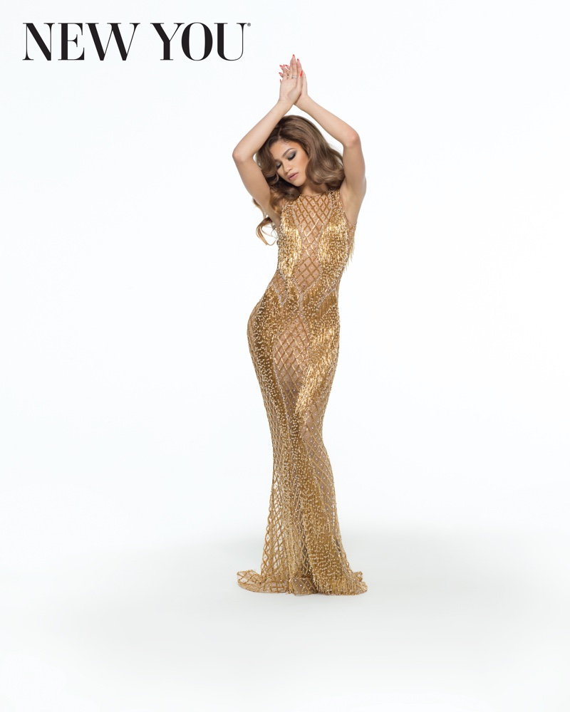 Zendaya also wears a slinky gold gown for the photoshoot