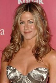 Jennifer-Aniston-Wavy-Hairstyle-Side-Part-Dark-Blonde