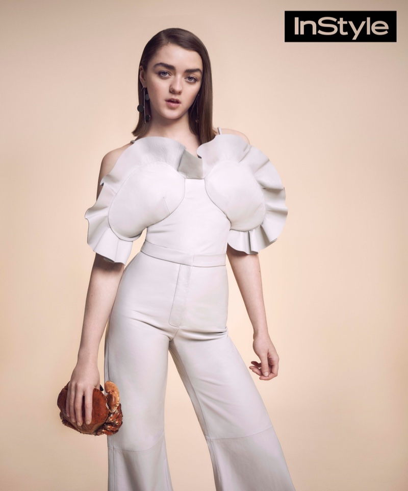 Starring in the April issue of InStyle UK, Maisie poses in a white jumpsuit with a pleated top
