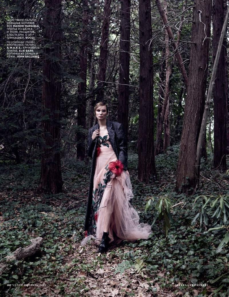 Posing in the woods, Natalia Daragan wears Gucci floral embroidered gown