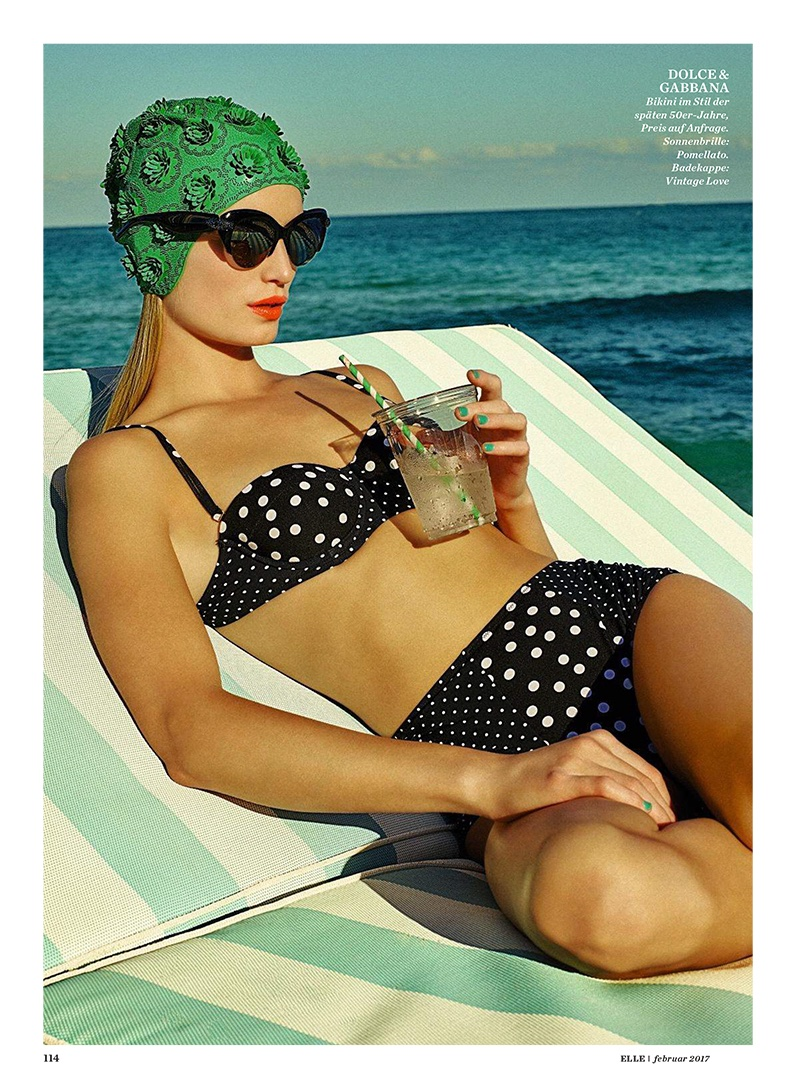 Lounging poolside, Maud Welzen wears Dolce & Gabbana polka dot print swimsuit and Pomellato sunglasses