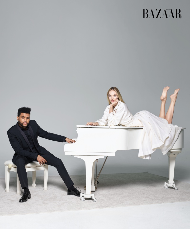 The Weeknd poses in Saint Laurent suit with Jimmy Choo shoes. Candice Swanepoel wears Chanel blouse and skirt with De Beers bracelet.