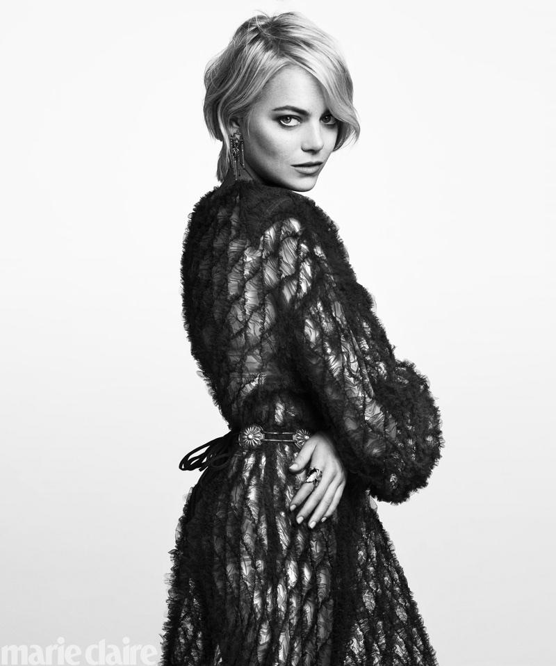 Actress Emma Stone poses in Valentino dress