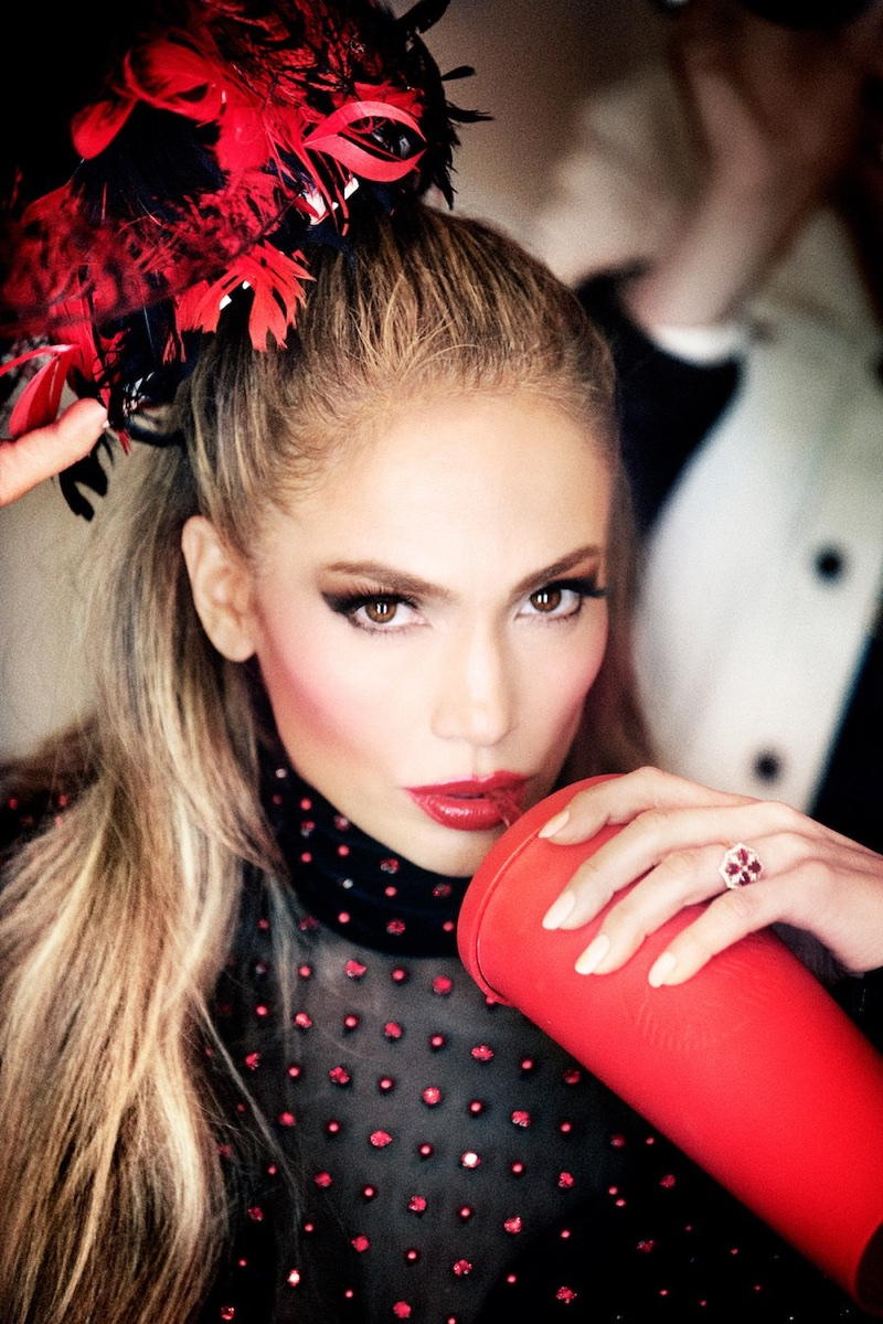 Showing off a red lip, Jennifer Lopez poses in The Blonds embellished bodysuit