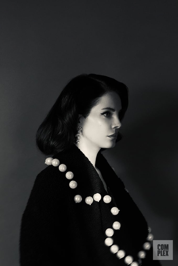 Lana Del Rey wears Maria Lucia Hohan jacket and Maxlor earrings
