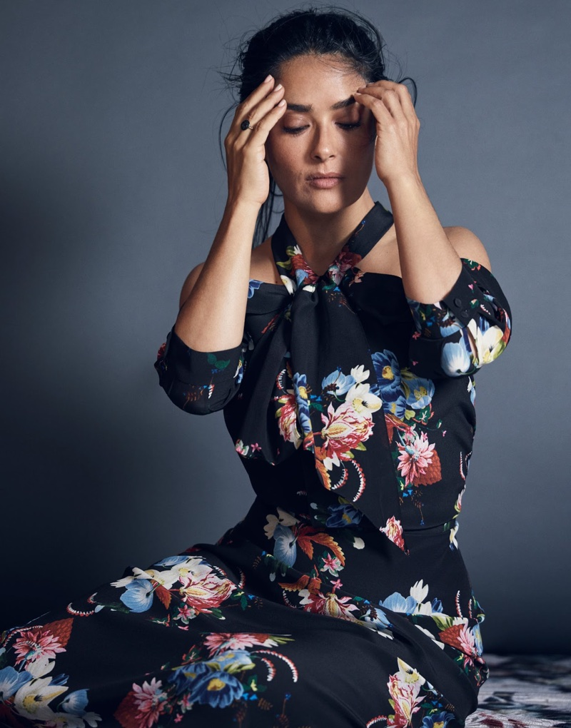 Flaunting some shoulder, Salma Hayek poses in Erdem floral print dress