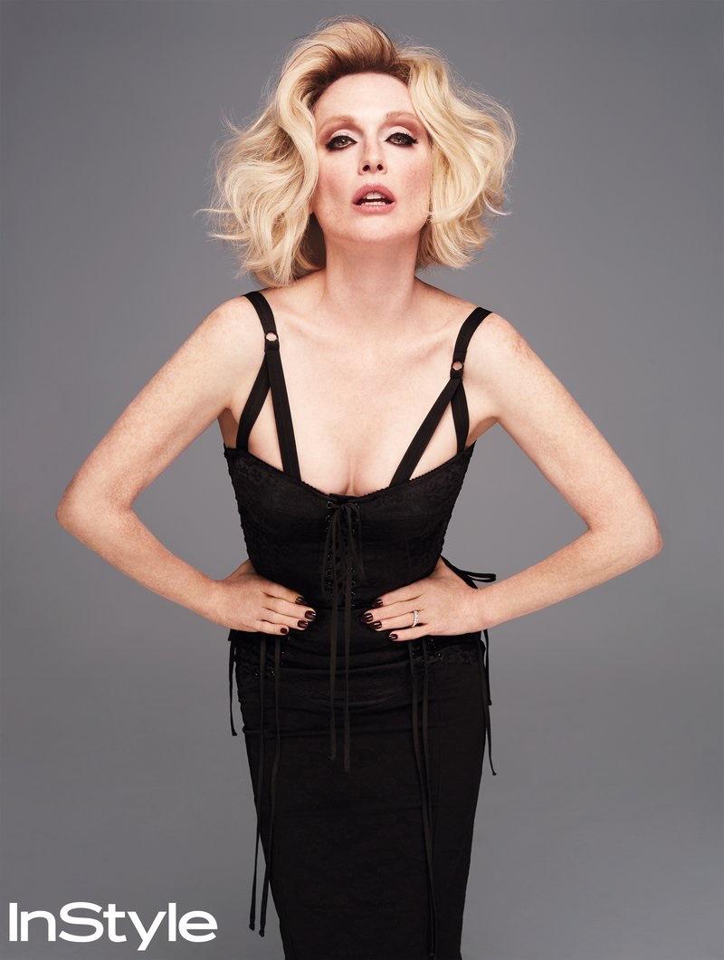 Posing as a blonde bombshell, Julianne Moore wears Dolce & Gabbana bustier top and skirt