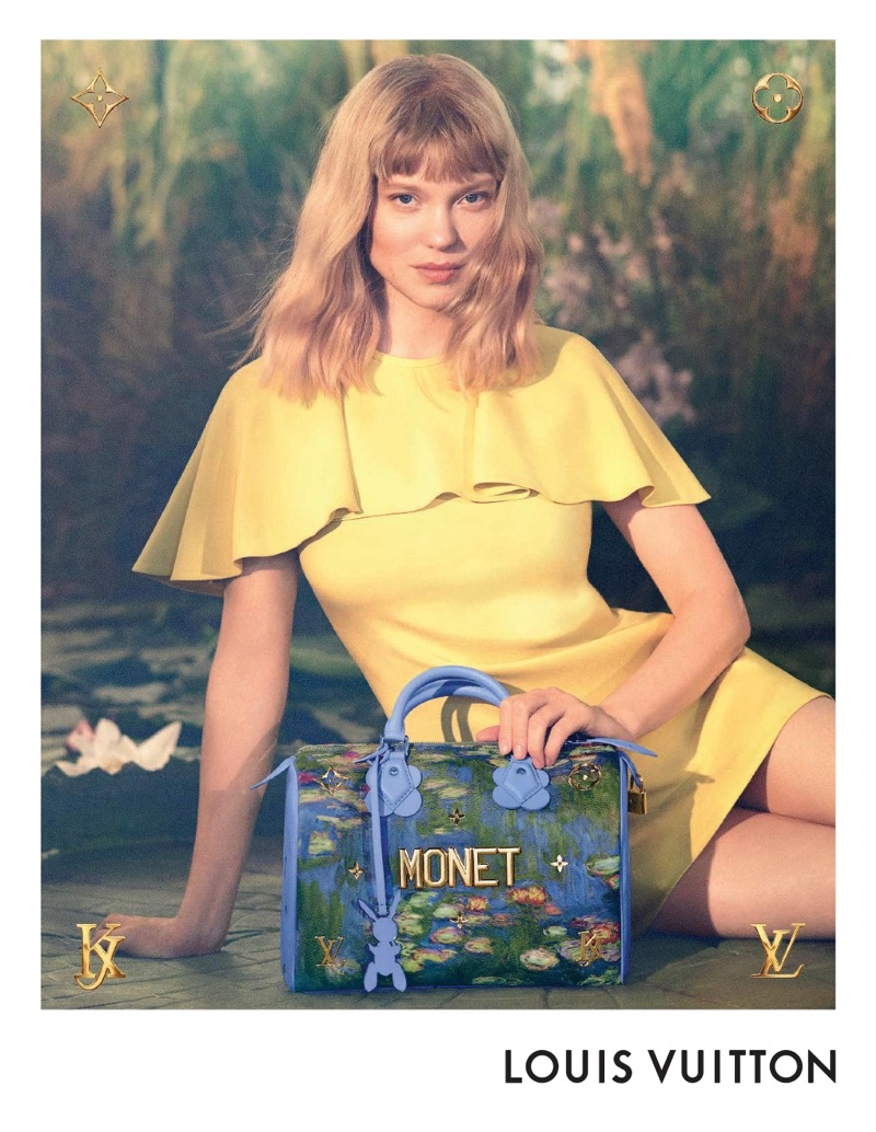 Actress Lea Seydoux poses with Monet handbag from Louis Vuitton x Jeff Koons collaboration