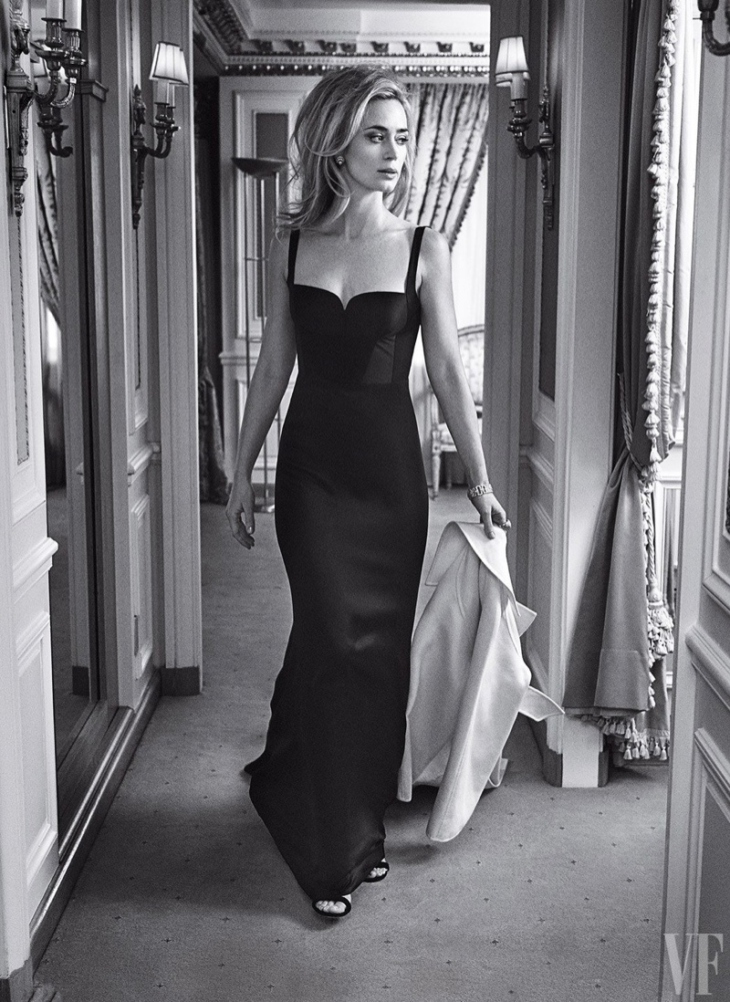 Photographed in black and white, Emily Blunt poses in gown