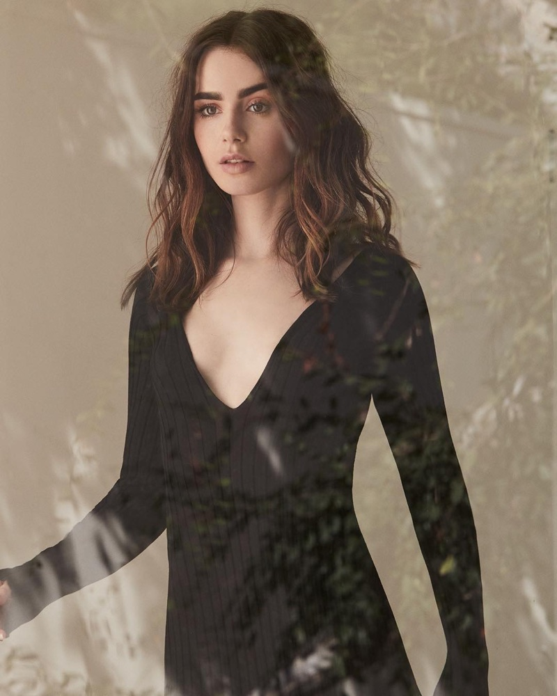 Wearing a little black dress, Lily Collins poses in design from The Line