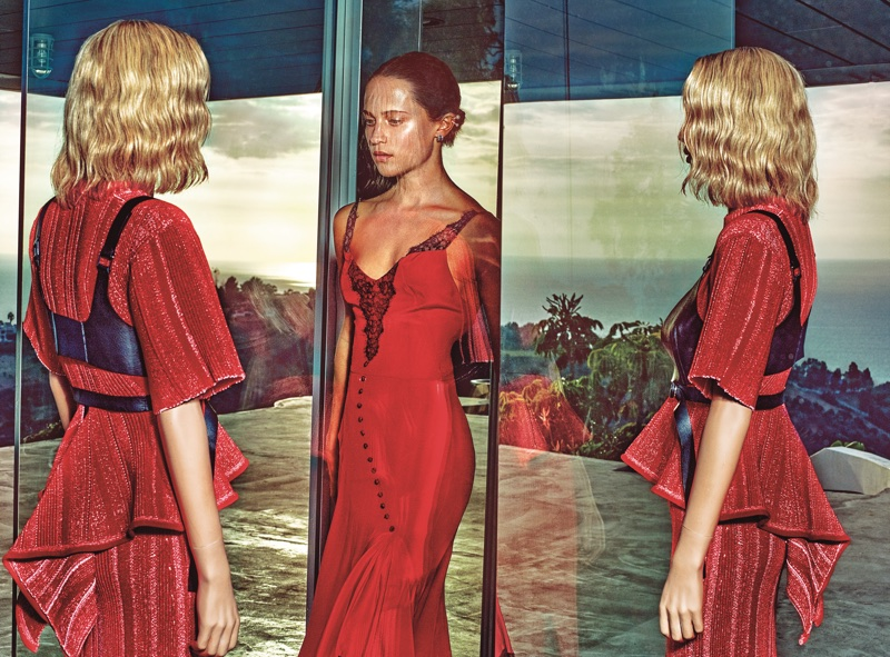 Actress Alicia Vikander poses in red Olivier Theyskens dress