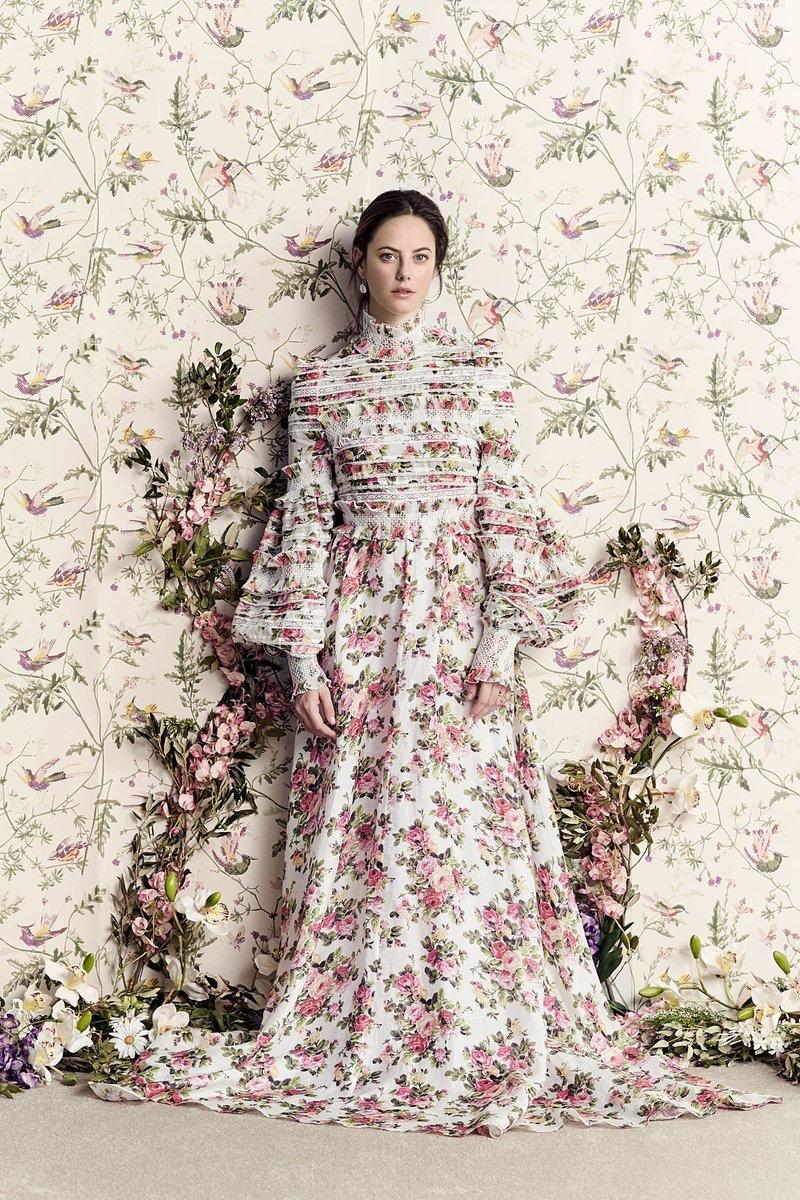 Actress Kaya Scodelario wears a maxi floral print dress