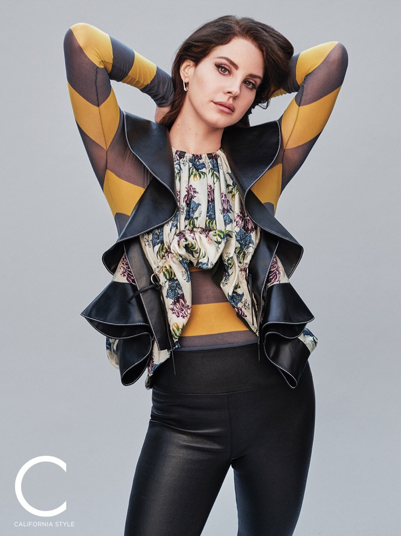 Singer Lana Del Rey poses in Louis Vuitton blouse and pullover with SPRWMN pants