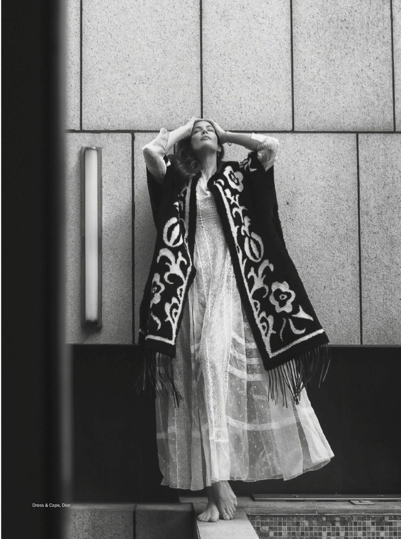 Photographed in black and white, Liv Tyler wears Dior cape and dress