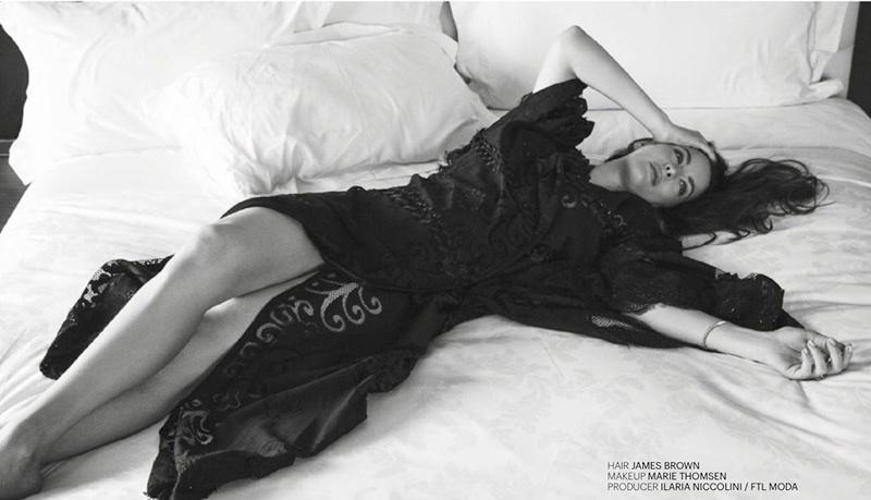 Posing in bed, Liv Tyler wears a robe