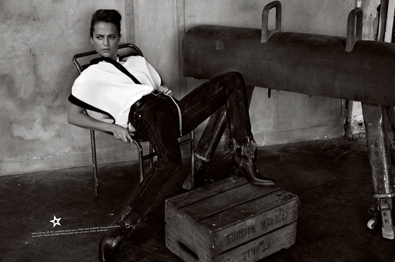 Actress Alicia Vikander wears Givenchy top and pants with Jessie Western boots