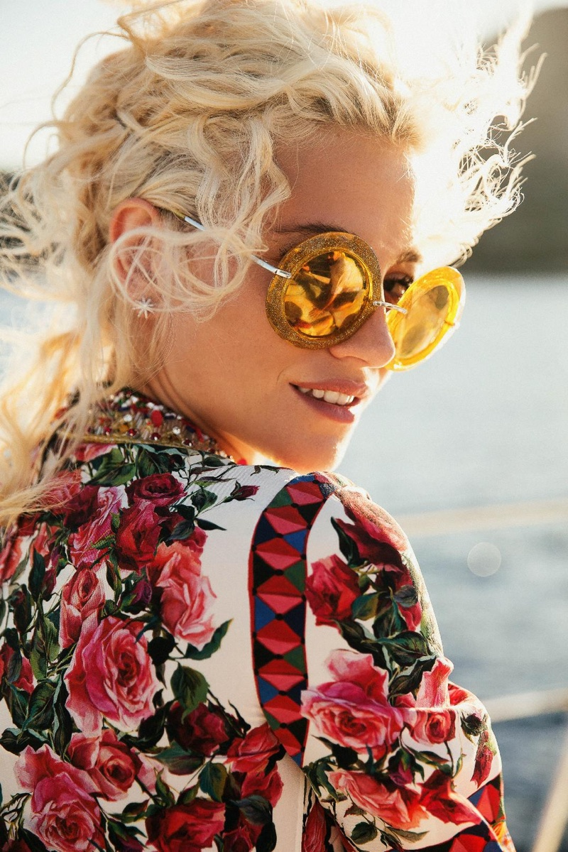Ready for her closeup, Pixie Lott wears gold sunglasses and floral print shirt