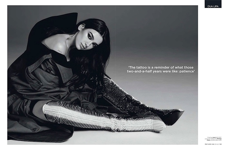 Photographed in black and white, Dua Lipa wears Juun J coat and Philipp Plein boots
