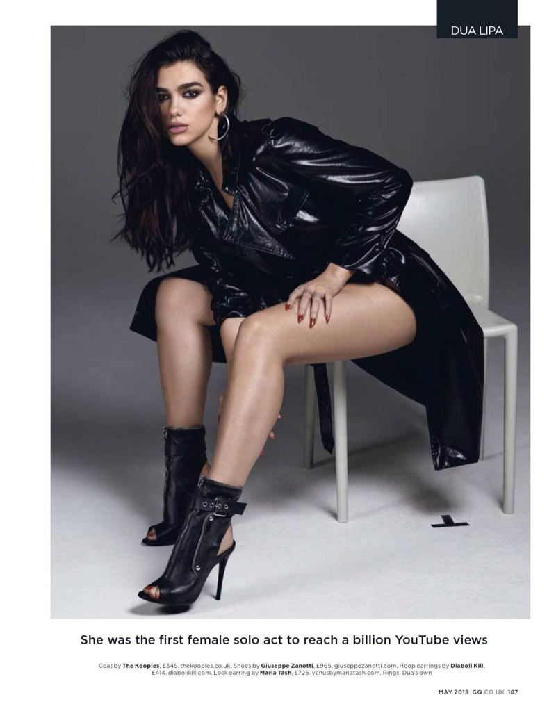 Dua Lipa wears The Kooples coat and Giuseppe Zanotti boots