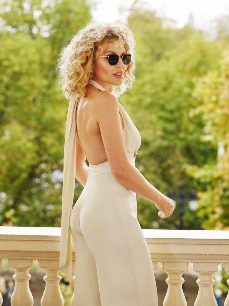 Rocking a jumpsuit, Kylie Minogue appears in Specsavers campaign