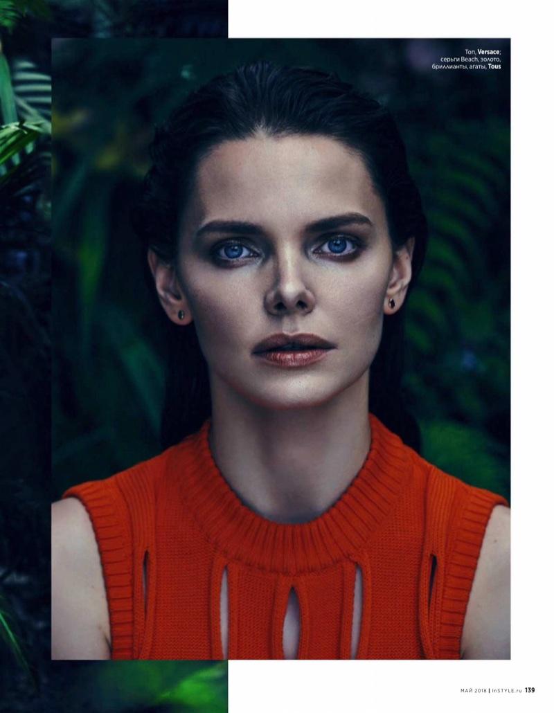 Ready for her closeup, Elizaveta Boyarskaya wears Versace top with Tous earrings