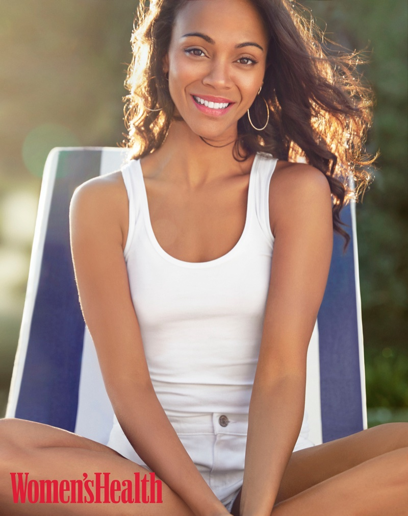 Zoe Saldana poses in Splendid tank top, Citizens of Humanity shorts and Eriness earrings