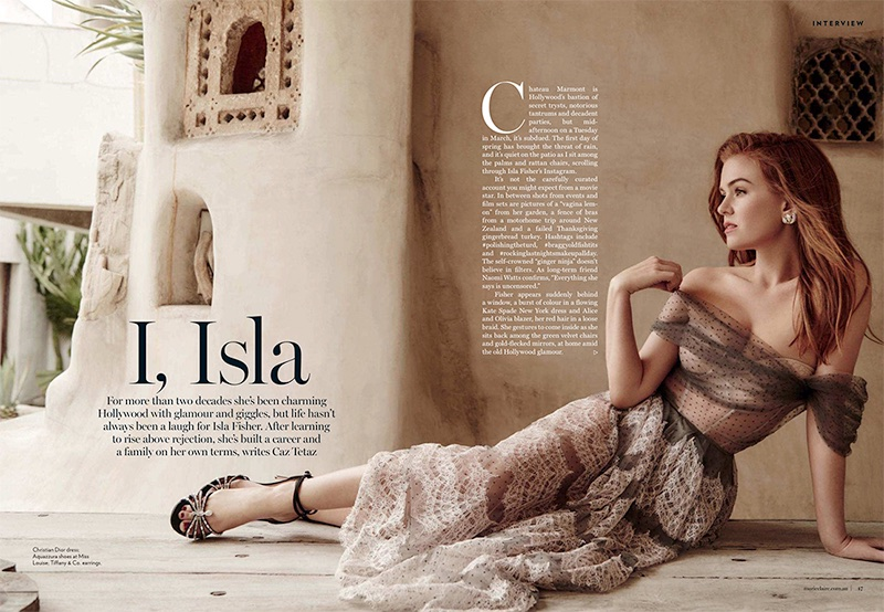 Actress Isla Fisher poses in Dior dress with Aquazzura sandals and Tiffany & Co. earrings