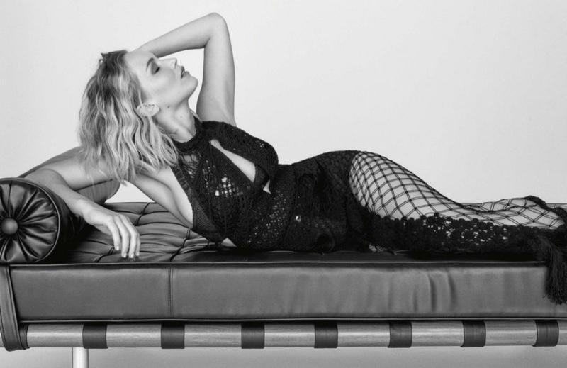 Lounging in black, Jennifer Lawrence wears Dior dress
