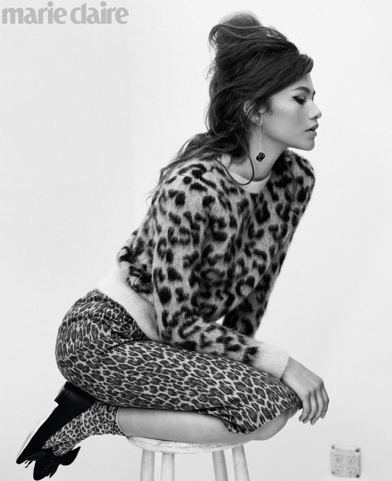 Zendaya wears Max Mara sweater and skirt; Chanel earrings and Manolo Blahnik flats