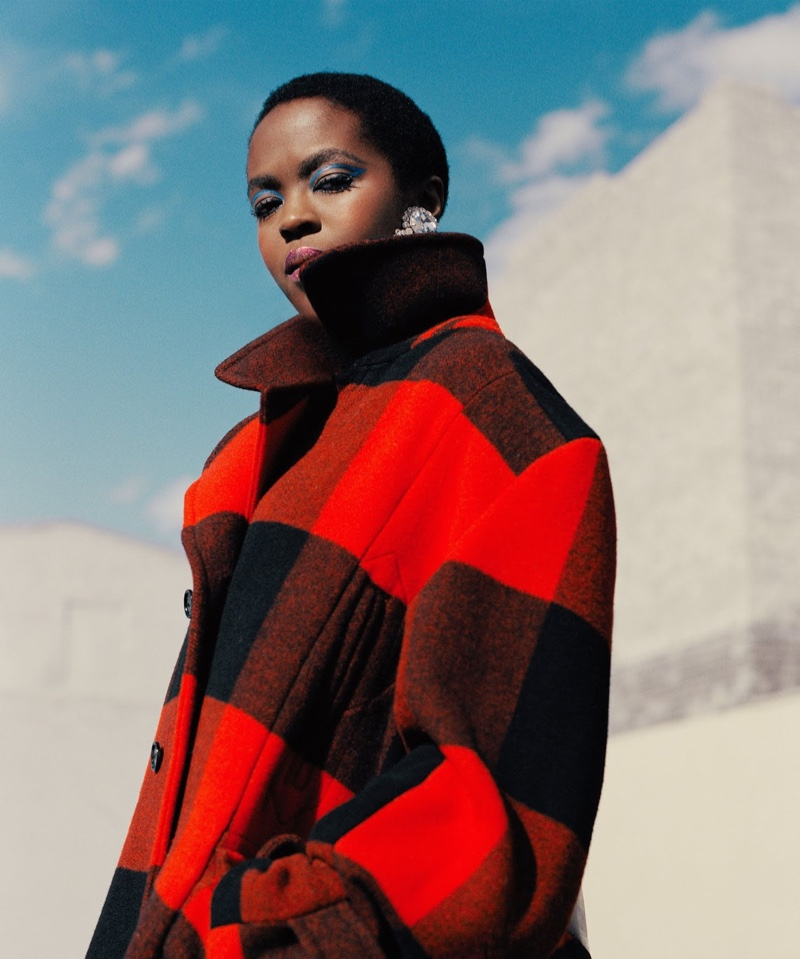 Singer Lauryn Hill poses in buffalo plaid coat for Woolrich fall-winter 2018 campaign