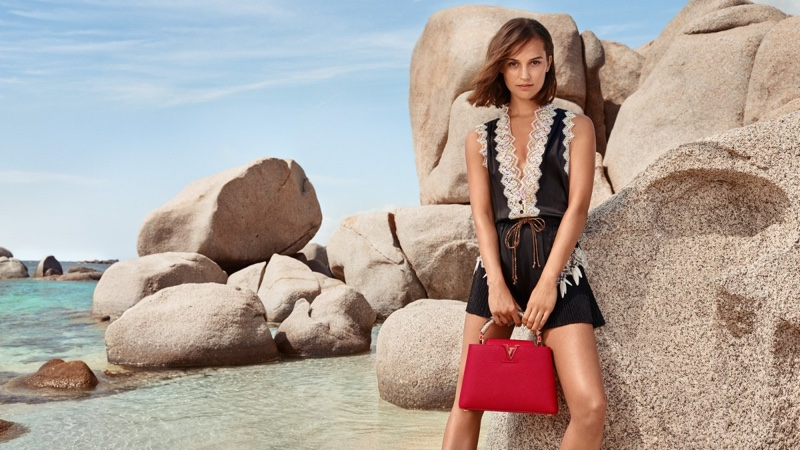 Alicia Vikander poses in Corsica for Louis Vuitton cruise 2019 campaign