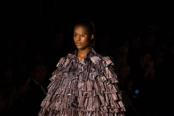 A model on the Apu Jan FW18 runway wearing an oversized jacked showcasing the design talent within the label