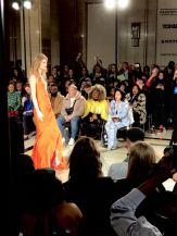 Malan Breton FW18 Fashion Scout London Fashion Week Lead a model wearing an amber coloured dress