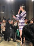 a model on the runway for STARSICA FW18 LONDON FASHION WEEK holding a hand mirror and looking at her reflection
