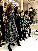 A group shot of male and female models blowing kisses from the steps at the Paul Costelloe FW18 show at London Fashion Week
