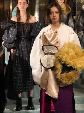 A close up of models demonstrating clashing textures at the minki FW18 presntation at the Park Chinois in Mayfair during London Fashion Week
