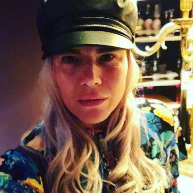 close up of Pixie Tenenbaum wearing a baker boy hat at the minki FW18 presentation for london Fashion Week
