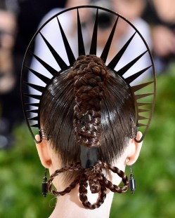 A close up image of lilly Collins intricate hair braids and headdress look at the 2018 Met Gala