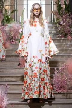A model wears a flower strewn dress in the Malene Oddershede Bach SS19 shoot by Chris Yates for Fashion Voyeur Blog