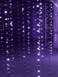 An image taken from the 2018 installation #MulberryLights at 100 Regent Street from fashion brand Mulberry as part of their Christmas campaign featuring some hanging string lights in white. Fashion Voyeur Blog