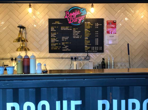 An image of the serving hatch and menu at Boojie Burger on the top deck of Stack Newcastle