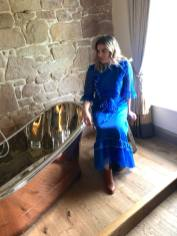 Pixie Tenenbaum sits on a milking stool next to a copper slipper tub at Beanell Towers Hotel in Northumberland   Fashion Voyeur Blog