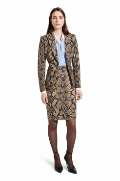 Go from the offi ce to after work cocktails with stylish ease in this look. Ultra-fl attering with its perfectly tailored proportions, this dress is a shirt and skirt in one, taking the guesswork out of dressing. LOOK 6 Blazer in Python Print, $49.99* ** Dress in Banker Stripe/Python Print, $49.99** Ankle Strap Shoe in Black, $39.99* *TARGET.COM EXCLUSIVE ** AVAILABLE GLOBALLY ON NET-A-PORTER.COM