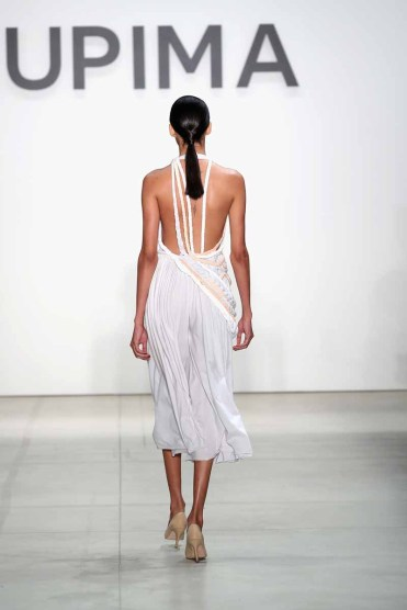 NEW YORK, NY - SEPTEMBER 08: A model walks the runway, hair detail, at the Supima Design Competition 2016 during New York Fashion Week: September 2016 at The Gallery, Skylight at Clarkson Sq on September 8, 2016 in New York City. (Photo by Neilson Barnard/Getty Images for Supima Design Competition)