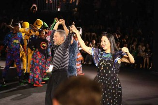 NEW YORK, NY - OCTOBER 19: Jean-Paul Goude and Carol Lim dance on the runway at the KENZO x H&M Launch Event Directed By Jean-Paul Goude' at Pier 36 on October 19, 2016 in New York City. (Photo by Thomas Concordia/Getty Images for H&M)