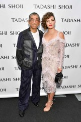 NEW YORK, NY - SEPTEMBER 07: Designer Tadashi Shoji and actress Camren Bicondova pose backstage before the Tadashi Shoji fashion show at Gallery 1, Skylight Clarkson Sq on September 7, 2017 in New York City. (Photo by Dia Dipasupil/Getty Images For Tadashi Shoji)