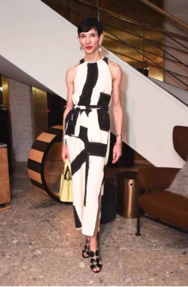 Amy Fine Collins in Max Mara black and cream print dress and yellow Whitney bag.