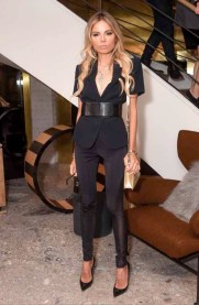 Erica Pelosini in Max Mara black short sleeve blazer, black leggings and black belt.